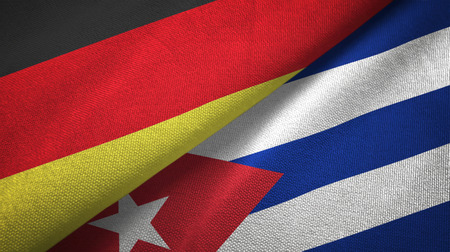 Germany and Cuba two folded flags together Stock Photo