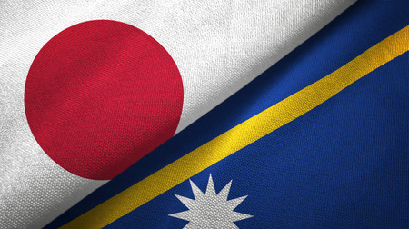 Japan and Nauru two folded flags together