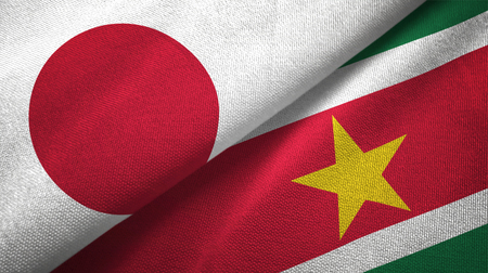 Japan and Suriname two folded flags together