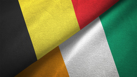 Belgium and Cote d'Ivoire Ivory coast two folded flags together Banque d'images - 117991397