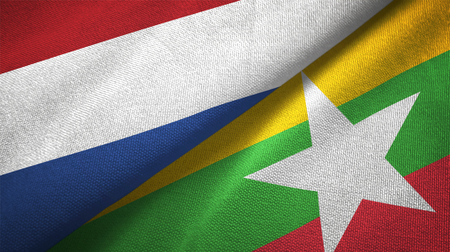 Netherlands and Myanmar two folded flags together Foto de archivo