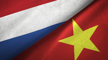 Netherlands and Vietnam two folded flags together Foto de archivo