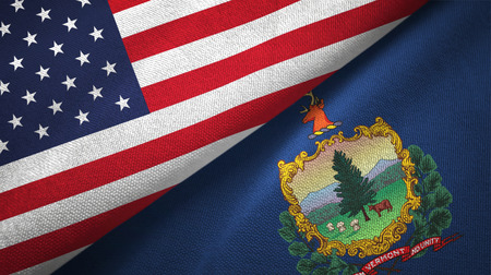 United States and Vermont state two folded flags together
