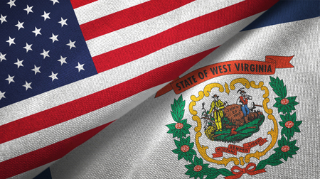 United States and West Virginia state two folded flags together