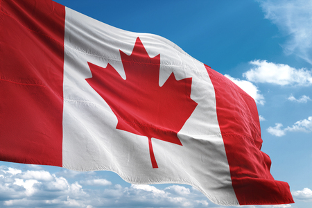 Canada flag waving blue sky background 3D illustration 写真素材