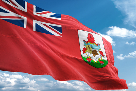 Bermuda flag waving blue sky background 3D illustration Imagens