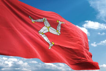 Isle of Mann flag waving blue sky background 3D illustration