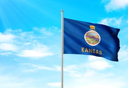 Kansas state of United States flag waving blue sky background 3D illustration 免版税图像