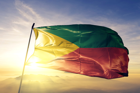 Zabaykalsky Krai oblast of Russia flag textile cloth fabric waving on the top sunrise mist fog