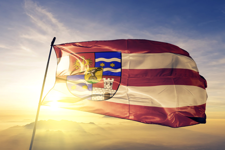 Varazdin county of Croatia flag textile cloth fabric waving on the top sunrise mist fog 免版税图像