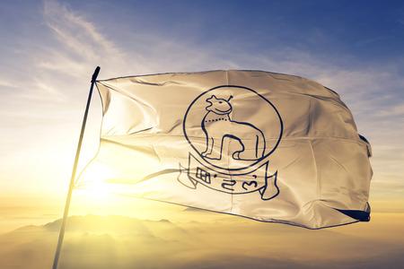 Manipur state of India flag textile cloth fabric waving on the top sunrise mist fog Фото со стока