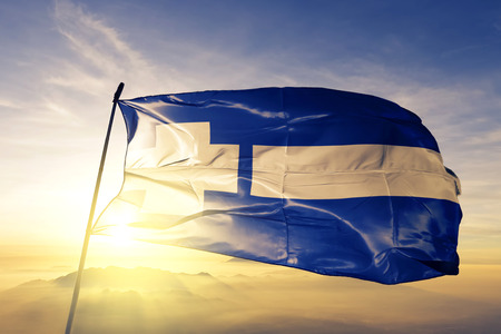 Thrace district of Greece flag textile cloth fabric waving on the top sunrise mist fog