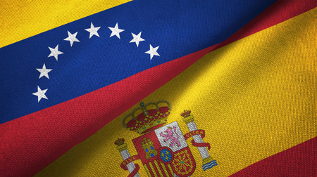 Venezuela and Spain flags together textile cloth, fabric texture