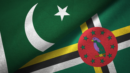 Pakistan and Dominica two folded flags together 写真素材