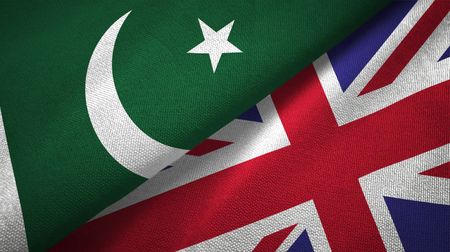 Pakistan and United Kingdom flags together textile cloth, fabric texture