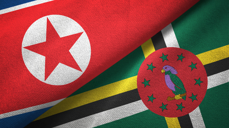 North Korea and Dominica two folded flags together 写真素材