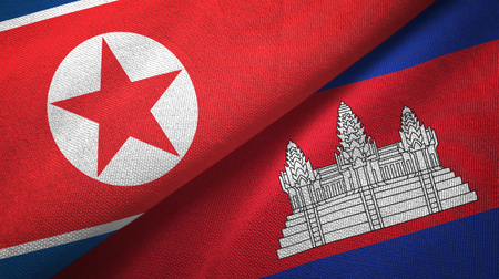 North Korea and Cambodia two folded flags together