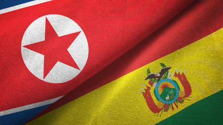 North Korea and Bolivia flags together textile cloth, fabric texture Stock Photo