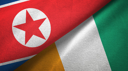 North Korea and Cote d'Ivoire Ivory coast two folded flags together Stock Photo