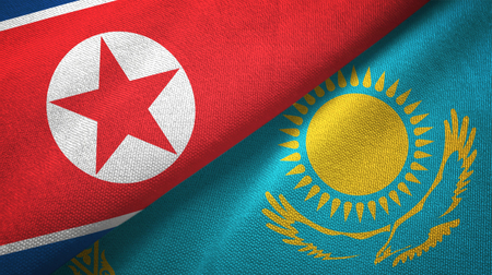 North Korea and Kazakhstan flags together textile cloth, fabric texture Stock Photo