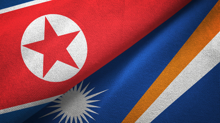 North Korea and Marshall Islands two folded flags together Stock Photo