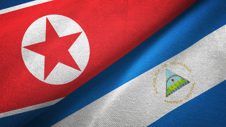 North Korea and Nicaragua two folded flags together