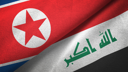 North Korea and Iraq flags together textile cloth, fabric texture. Text on iraqi flag means - God is the greatest Foto de archivo