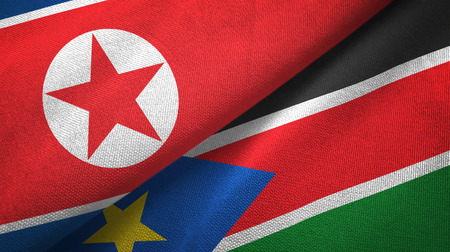 North Korea and South Sudan two folded flags together Stock Photo
