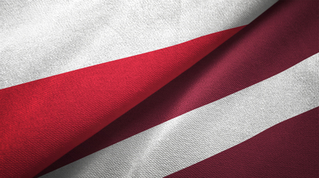 Poland and Latvia flags together textile cloth, fabric texture 写真素材