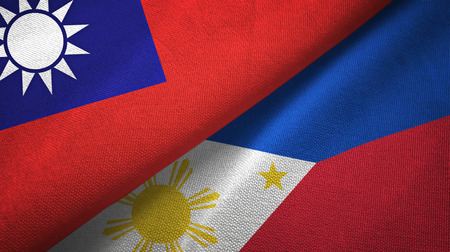 Taiwan and Philippines two folded flags together Stock Photo