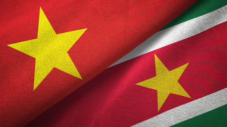 Vietnam and Suriname two folded flags together