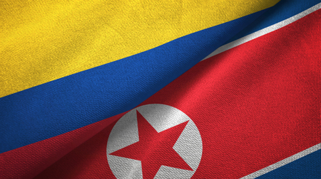 Colombia and North Korea two folded flags together Stock Photo
