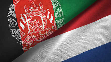 Afghanistan and Netherlands flags together textile cloth, fabric texture Foto de archivo