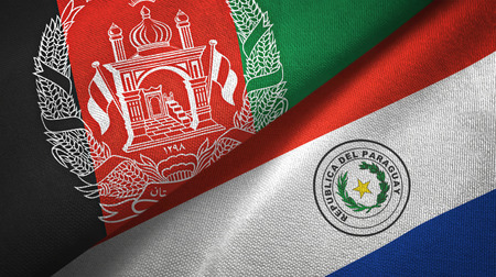 Afghanistan and Paraguay flags together textile cloth, fabric texture Reklamní fotografie