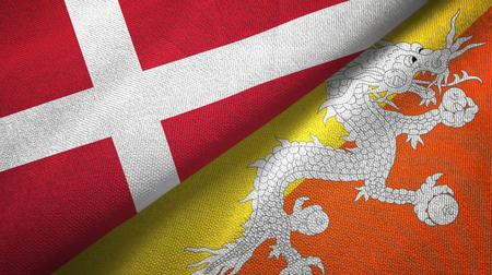 Denmark and Bhutan two folded flags together Stock Photo
