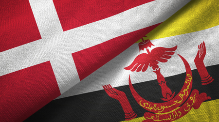 Denmark and Brunei Darussalam flags together textile cloth, fabric texture. Text on brunei flag means - Always in service with God's guidance