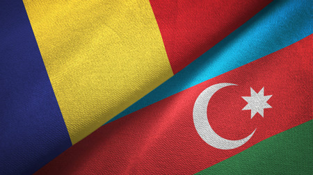 Romania and Azerbaijan flags together textile cloth, fabric texture Foto de archivo