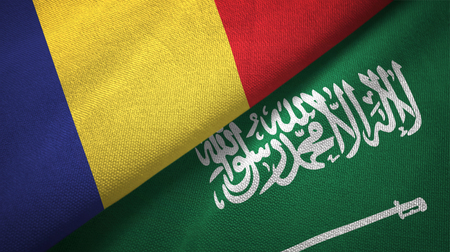 Romania and Saudi Arabia flags textile cloth, fabric texture. Text on saudi arabian flag means - There is no god but God, Muhammad is the Messenger of God Foto de archivo
