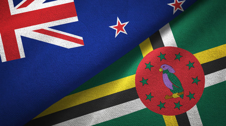 New Zealand and Dominica two folded flags together 写真素材