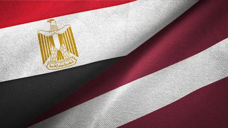 Egypt and Latvia flags together textile cloth, fabric texture Stok Fotoğraf