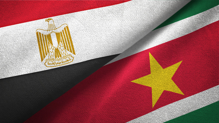 Egypt and Suriname two folded flags together