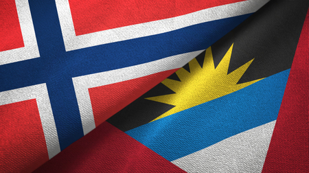 Norway and Antigua and Barbuda two folded flags together Stock Photo