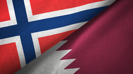 Norway and Qatar flags together textile cloth, fabric texture Stock Photo