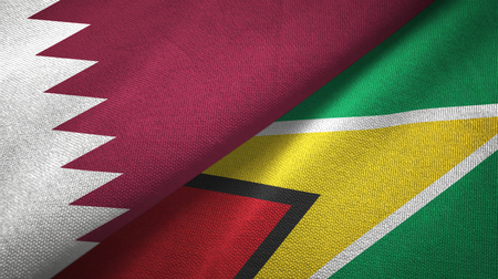 Qatar and Guyana two folded flags together Stock Photo