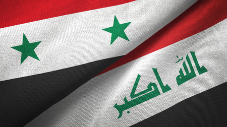 Syria and Iraq flags together textile cloth, fabric texture. Text on iraqi flag means - God is the greatest