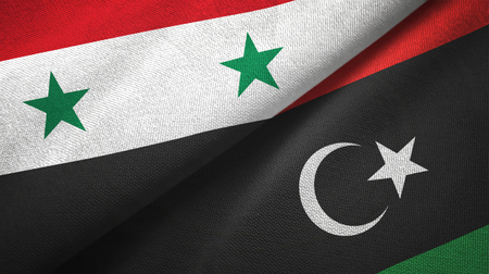 Syria and Libya flags together textile cloth, fabric texture Archivio Fotografico