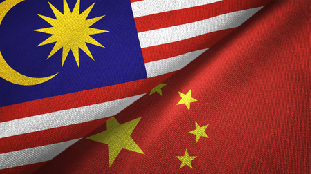 Malaysia and China flags together textile cloth, fabric texture 스톡 콘텐츠