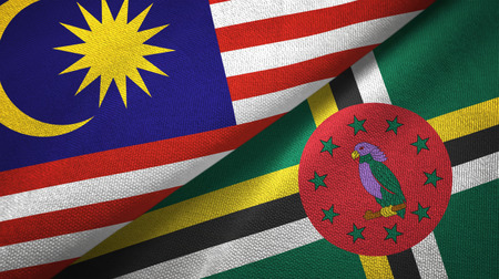 Malaysia and Dominica two folded flags together