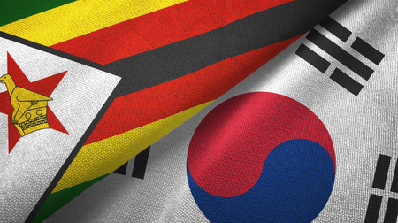 Zimbabwe and South Korea flags together textile cloth, fabric texture Stock Photo