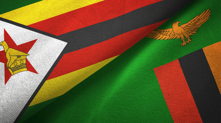 Zimbabwe and Zambia two folded flags together Stock Photo